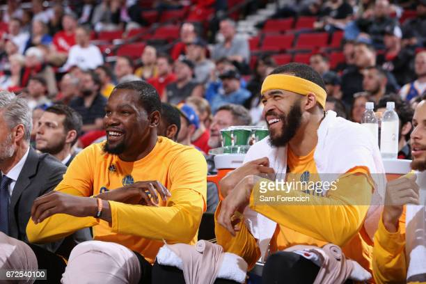 JaVale McGee and Kevin Durant of the Golden State Warriors smile during the game against the Portland Trail Blazers of the Golden State Warriors...