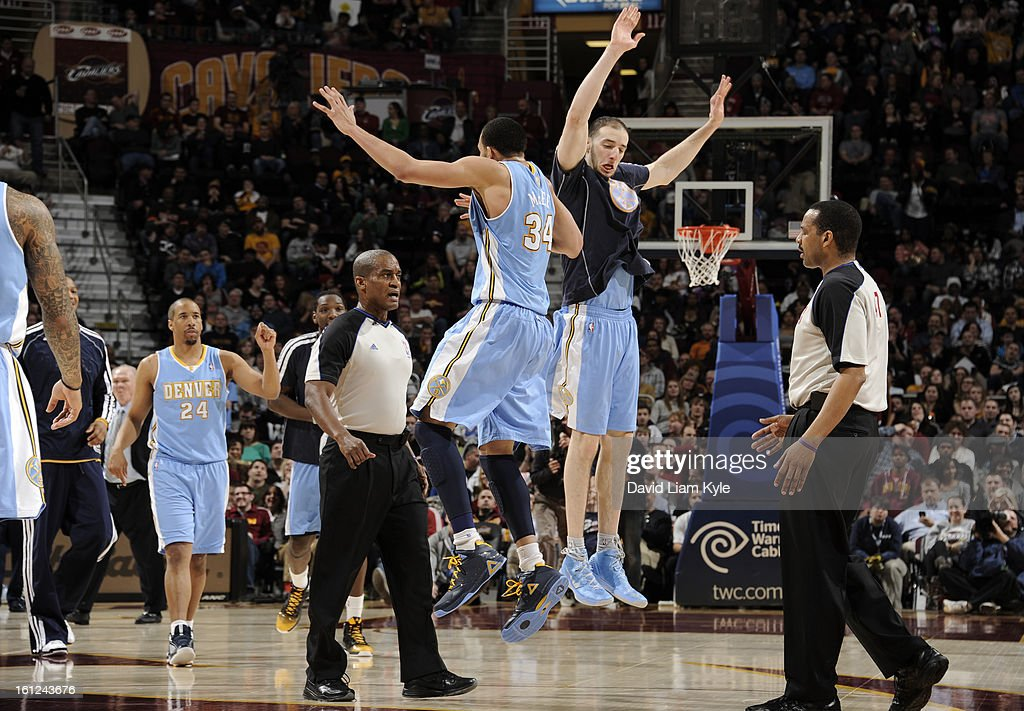 JaVale McGee #34 and Kosta Koufos #41 of the Denver Nuggets celebrate after a tip in as time expired in the third quarter of the game against the Cleveland Cavaliers at The Quicken Loans Arena on February 9, 2013 in Cleveland, Ohio.