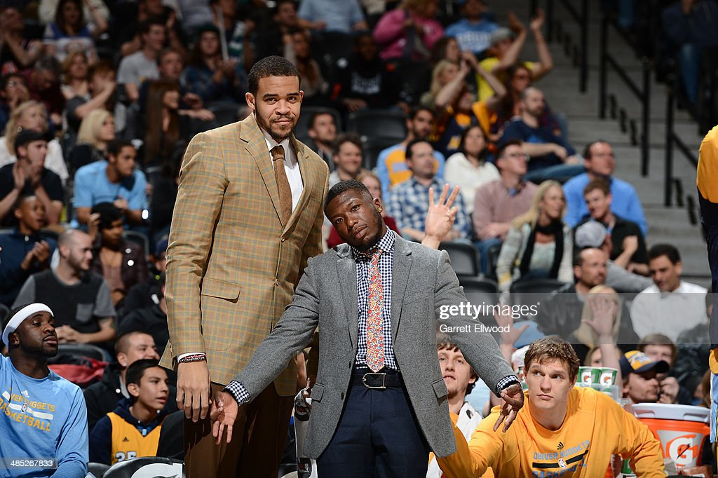 JaVale McGee #34 and Nate Robinson #10 of the Denver Nuggets pose for a picture during the game against the Golden State Warriors on April 16, 2014 at the Pepsi Center in Denver, Colorado.