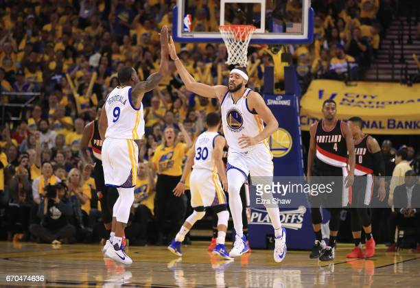 JaVale McGee highfives Andre Iguodala of the Golden State Warriors during their game against the Portland Trail Blazers in Game Two of the Western...
