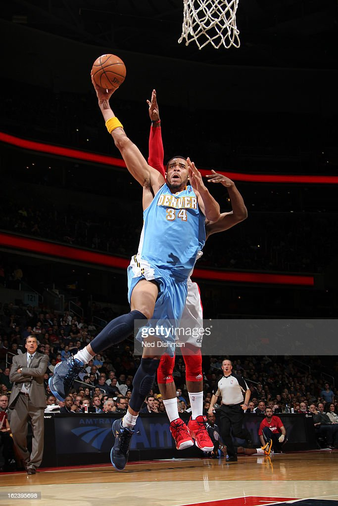 <a gi-track='captionPersonalityLinkClicked' href=/galleries/search?phrase=JaVale+McGee&family=editorial&specificpeople=4195625 ng-click='$event.stopPropagation()'>JaVale McGee</a> #34 of the Denver Nuggets attempts a dunk against <a gi-track='captionPersonalityLinkClicked' href=/galleries/search?phrase=John+Wall&family=editorial&specificpeople=2265812 ng-click='$event.stopPropagation()'>John Wall</a> #2 of the Washington Wizards during the game at the Verizon Center on February 22, 2013 in Washington, DC.