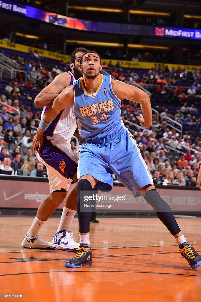 <a gi-track='captionPersonalityLinkClicked' href=/galleries/search?phrase=JaVale+McGee&family=editorial&specificpeople=4195625 ng-click='$event.stopPropagation()'>JaVale McGee</a> #34 of the Denver Nuggets awaits a rebound against the Phoenix Suns on March 11, 2013 at U.S. Airways Center in Phoenix, Arizona.