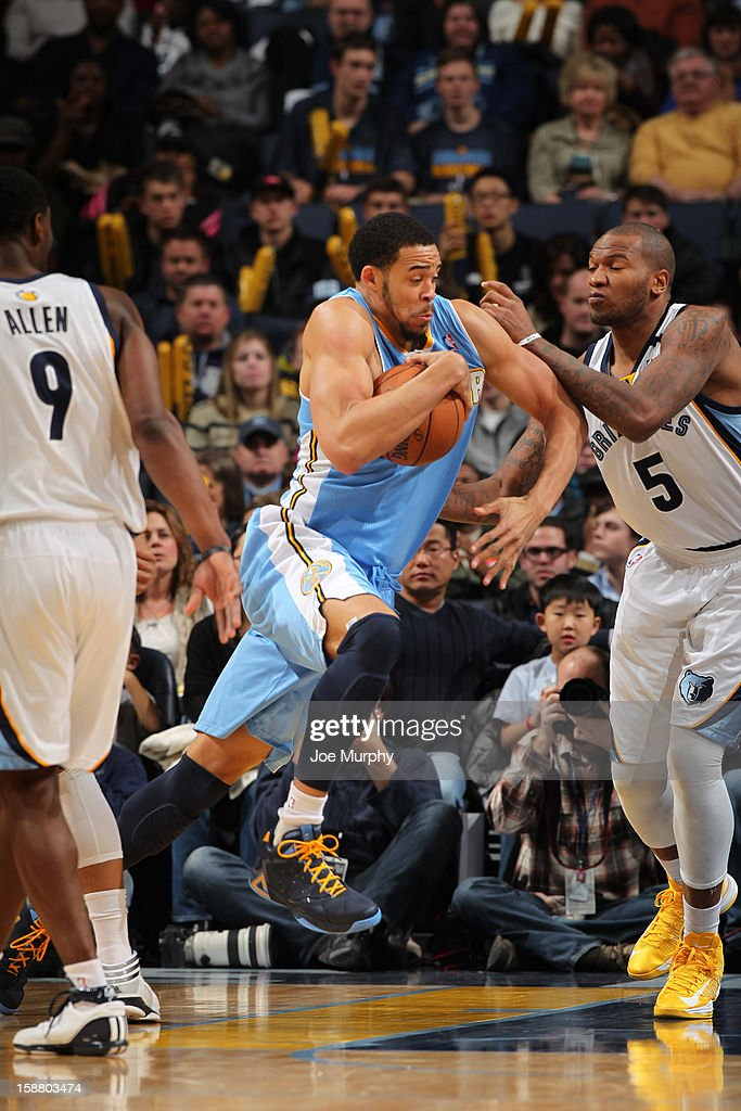 JaVale McGee #34 of the Denver Nuggets drives against Marreese Speights #5 of the Memphis Girzzlies on December 29, 2012 at FedExForum in Memphis, Tennessee.