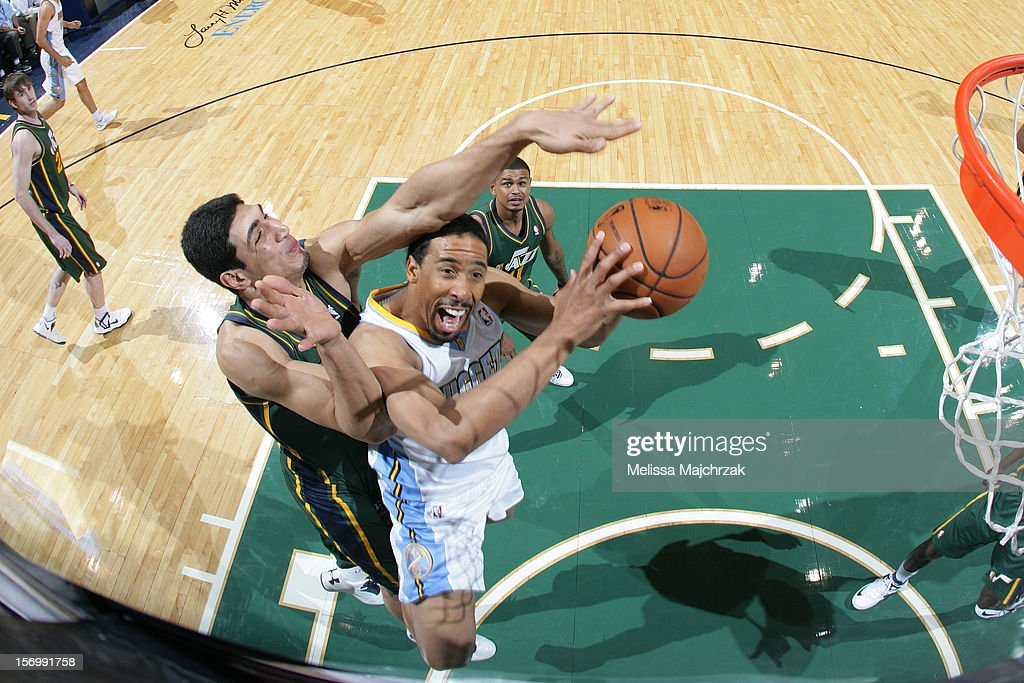 <a gi-track='captionPersonalityLinkClicked' href=/galleries/search?phrase=JaVale+McGee&family=editorial&specificpeople=4195625 ng-click='$event.stopPropagation()'>JaVale McGee</a> #34 of the Denver Nuggets drives to the basket against <a gi-track='captionPersonalityLinkClicked' href=/galleries/search?phrase=Enes+Kanter&family=editorial&specificpeople=5621416 ng-click='$event.stopPropagation()'>Enes Kanter</a> #0 of the Utah Jazz at Energy Solutions Arena on November 26, 2012 in Salt Lake City, Utah.