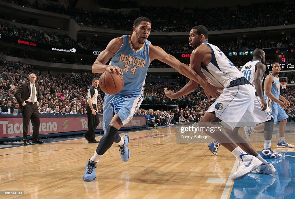 JaVale McGee #34 of the Denver Nuggets drives to the basket against Brandan Wright #34 of the Dallas Mavericks on December 28, 2012 at the American Airlines Center in Dallas, Texas.