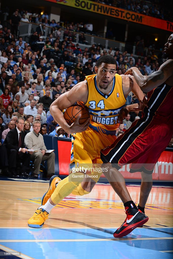 JaVale McGee #34 of the Denver Nuggets drives to the basket against the Miami Heat on November 15, 2012 at the Pepsi Center in Denver, Colorado.