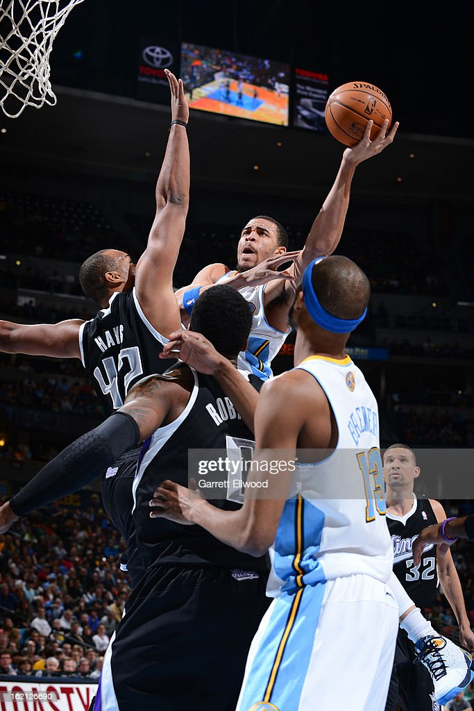 <a gi-track='captionPersonalityLinkClicked' href=/galleries/search?phrase=JaVale+McGee&family=editorial&specificpeople=4195625 ng-click='$event.stopPropagation()'>JaVale McGee</a> #34 of the Denver Nuggets drives to the basket against the Sacramento Kings on January 26, 2013 at the Pepsi Center in Denver, Colorado.