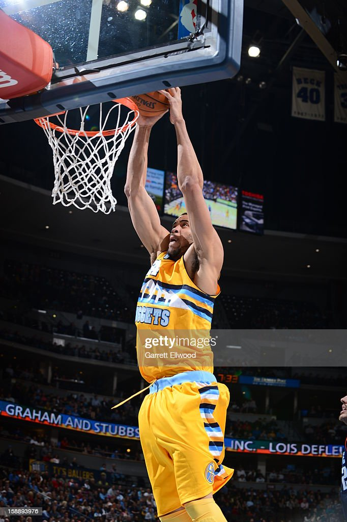 JaVale McGee #34 of the Denver Nuggets dunks against the Charlotte Bobcats on December 22, 2012 at the Pepsi Center in Denver, Colorado.