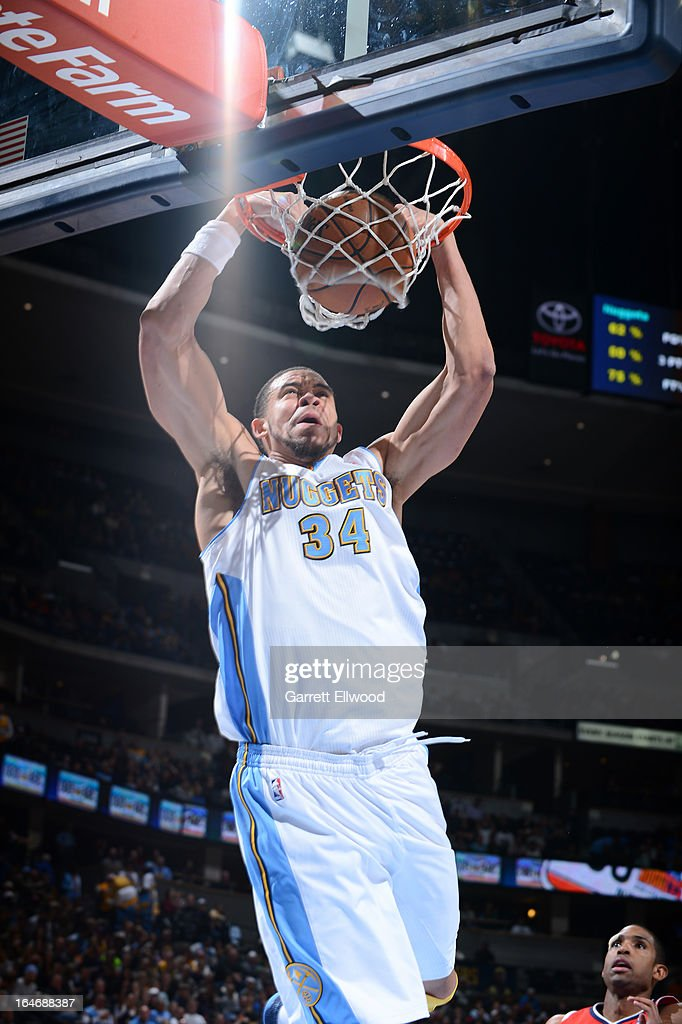 JaVale McGee #34 of the Denver Nuggets dunks the ball against the Atlanta Hawks on March 4, 2013 at the Pepsi Center in Denver, Colorado.