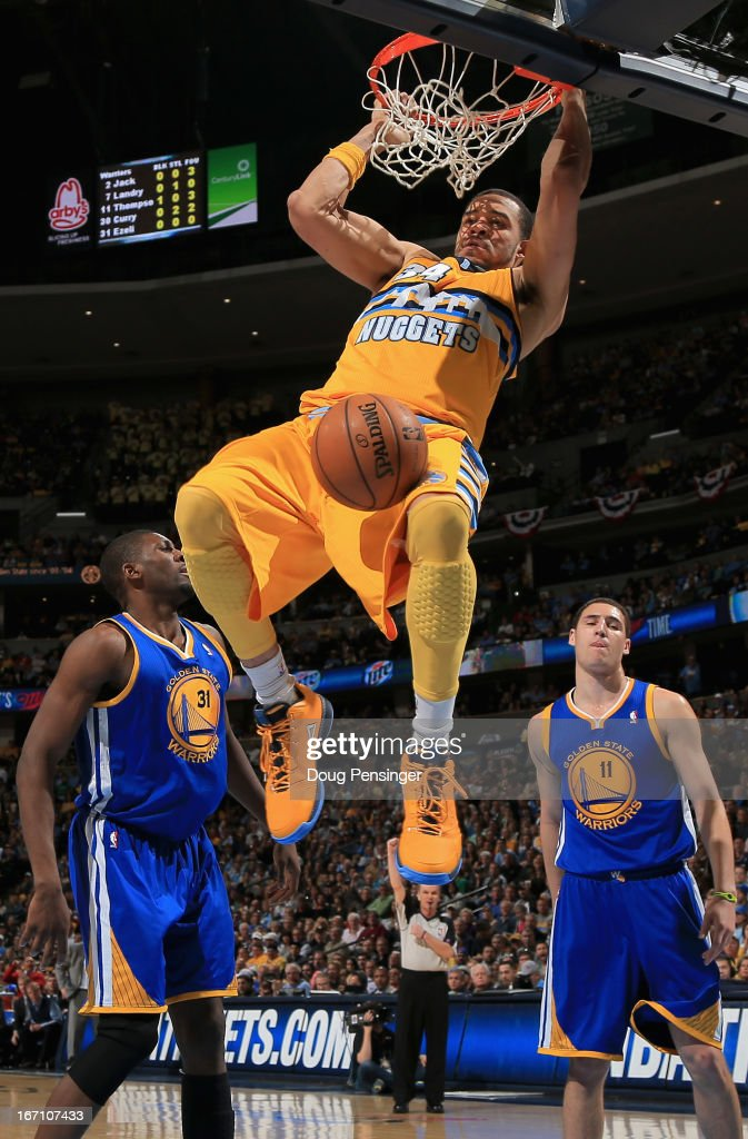 <a gi-track='captionPersonalityLinkClicked' href=/galleries/search?phrase=JaVale+McGee&family=editorial&specificpeople=4195625 ng-click='$event.stopPropagation()'>JaVale McGee</a> #34 of the Denver Nuggets dunks the ball as he was fouled by <a gi-track='captionPersonalityLinkClicked' href=/galleries/search?phrase=Festus+Ezeli&family=editorial&specificpeople=5725219 ng-click='$event.stopPropagation()'>Festus Ezeli</a> #31 of the Golden State Warriors during Game One of the Western Conference Quarterfinals of the 2013 NBA Playoffs at the Pepsi Center on April 20, 2013 in Denver, Colorado. The Nuggets defeated the Warriors 97-95.