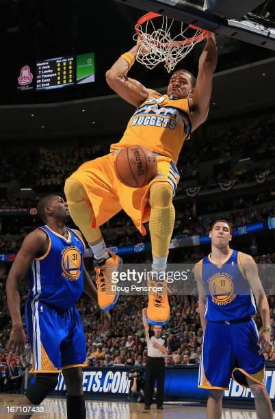 JaVale McGee of the Denver Nuggets dunks the ball as he was fouled by Festus Ezeli of the Golden State Warriors during Game One of the Western...