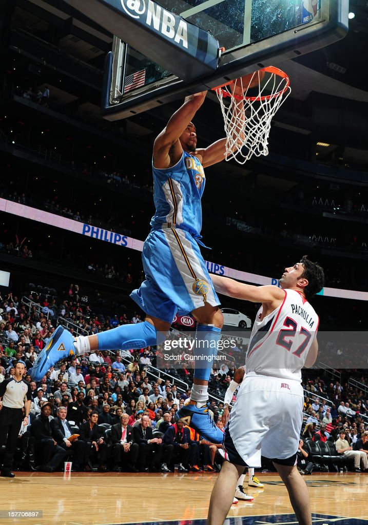 <a gi-track='captionPersonalityLinkClicked' href=/galleries/search?phrase=JaVale+McGee&family=editorial&specificpeople=4195625 ng-click='$event.stopPropagation()'>JaVale McGee</a> #34 of the Denver Nuggets dunks the ball over <a gi-track='captionPersonalityLinkClicked' href=/galleries/search?phrase=Zaza+Pachulia&family=editorial&specificpeople=202939 ng-click='$event.stopPropagation()'>Zaza Pachulia</a> #27 of the Atlanta Hawks at Philips Arena on December 5, 2012 in Atlanta, Georgia.