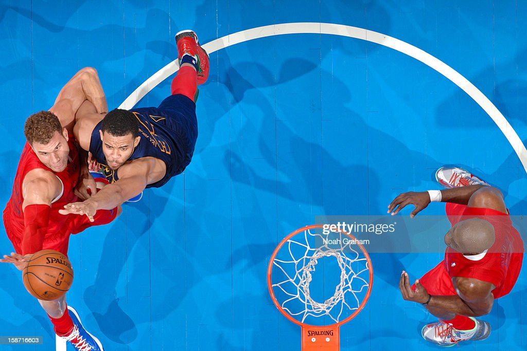 JaVale McGee #34 of the Denver Nuggets fights for a rebound against Blake Griffin #32 of the Los Angeles Clippers during a Christmas Day game at Staples Center on December 25, 2012 in Los Angeles, California.