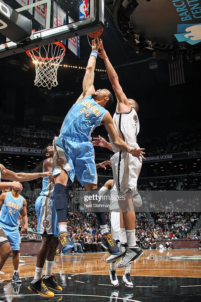 <a gi-track='captionPersonalityLinkClicked' href=/galleries/search?phrase=JaVale+McGee&family=editorial&specificpeople=4195625 ng-click='$event.stopPropagation()'>JaVale McGee</a> #34 of the Denver Nuggets fights for the rebound against the Brooklyn Nets on February 13, 2013 at the Barclays Center in the Brooklyn borough of New York City in New York City.