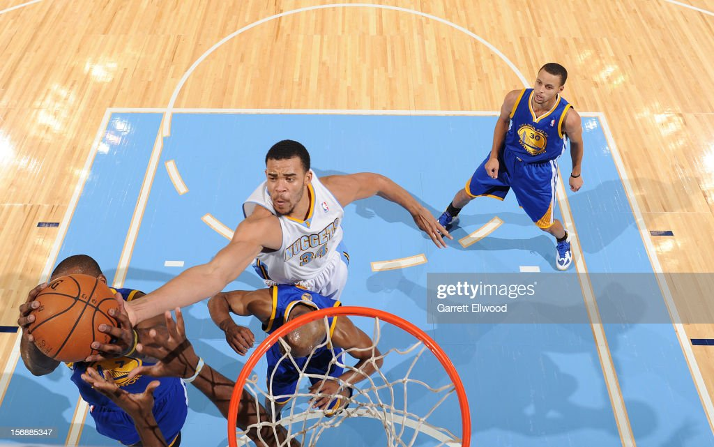 JaVale McGee #34 of the Denver Nuggets goes for a rebound against the Golden State Warriors on November 23, 2012 at the Pepsi Center in Denver, Colorado.