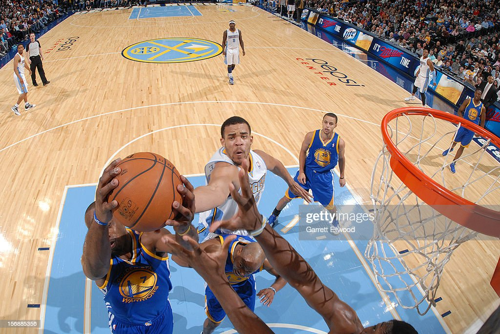 <a gi-track='captionPersonalityLinkClicked' href=/galleries/search?phrase=JaVale+McGee&family=editorial&specificpeople=4195625 ng-click='$event.stopPropagation()'>JaVale McGee</a> #34 of the Denver Nuggets goes up for a rebound against <a gi-track='captionPersonalityLinkClicked' href=/galleries/search?phrase=Carl+Landry&family=editorial&specificpeople=4111952 ng-click='$event.stopPropagation()'>Carl Landry</a> #7 of the Golden State Warriors on November 23, 2012 at the Pepsi Center in Denver, Colorado.