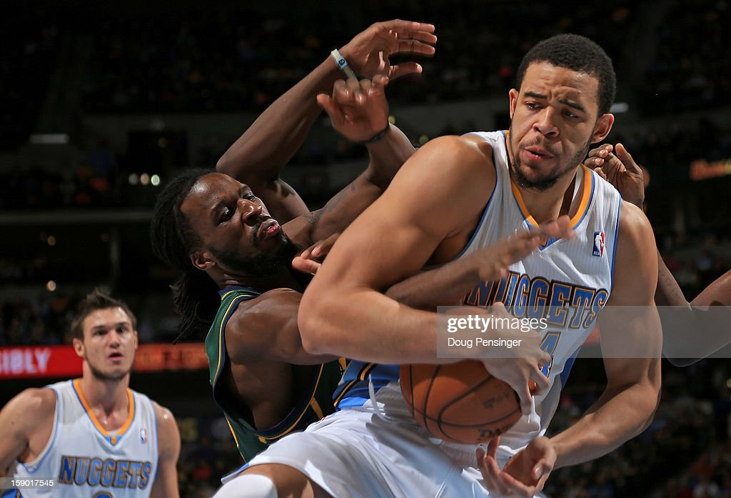 JaVale McGee #34 of the Denver Nuggets grabs a rebound away from DeMarre Carroll #3 of the Utah Jazz at the Pepsi Center on January 5, 2013 in Denver, Colorado. The Nuggets defeated the Jazz 110-91.
