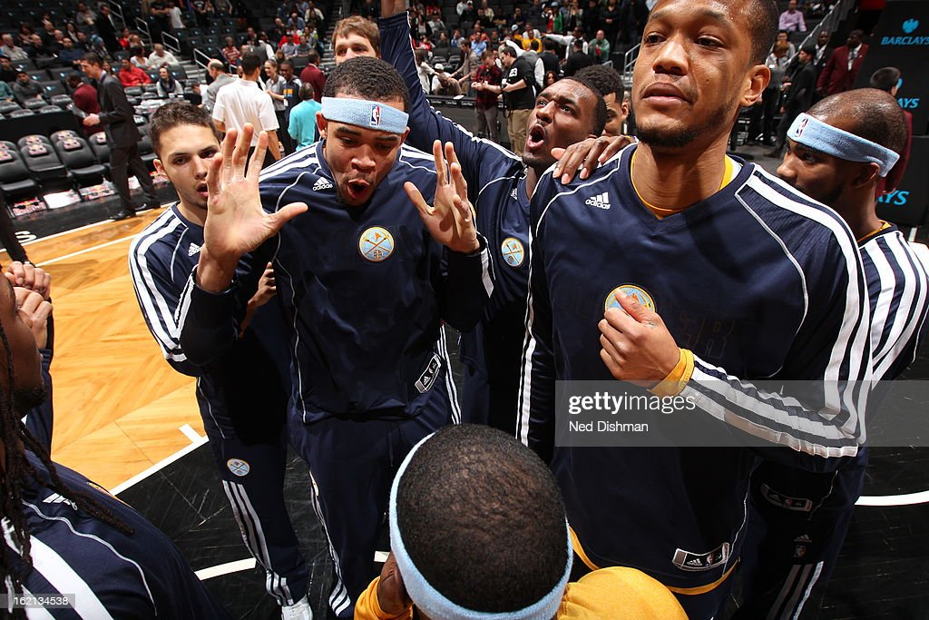 JaVale McGee #34 of the Denver Nuggets huddles before the game against the Brooklyn Nets on February 13, 2013 at the Barclays Center in the Brooklyn borough of New York City in New York City.