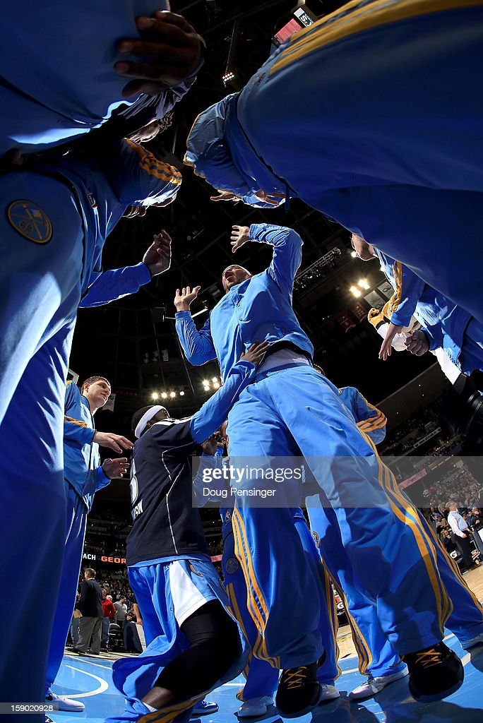 <a gi-track='captionPersonalityLinkClicked' href=/galleries/search?phrase=JaVale+McGee&family=editorial&specificpeople=4195625 ng-click='$event.stopPropagation()'>JaVale McGee</a> #34 of the Denver Nuggets is at the center of the team as they prepare to face the Utah Jazz at the Pepsi Center on January 5, 2013 in Denver, Colorado. The Nuggets defeated the Jazz 110-91.