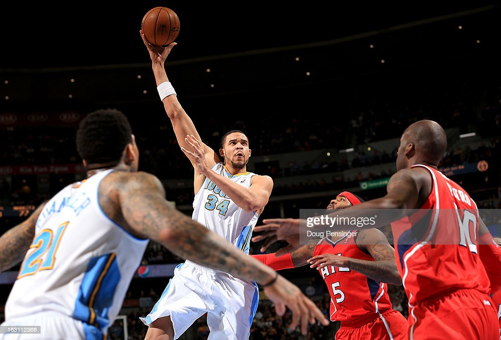<a gi-track='captionPersonalityLinkClicked' href=/galleries/search?phrase=JaVale+McGee&family=editorial&specificpeople=4195625 ng-click='$event.stopPropagation()'>JaVale McGee</a> #34 of the Denver Nuggets lays up a shot against the Atlanta Hawks at the Pepsi Center on March 4, 2013 in Denver, Colorado. The Nuggets defeated the Hawks 104-88.