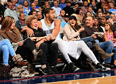 JaVale McGee of the Denver Nuggets protects the fans as he ended up in the front row after saving the ball against the New Orleans Pelicans at Pepsi...