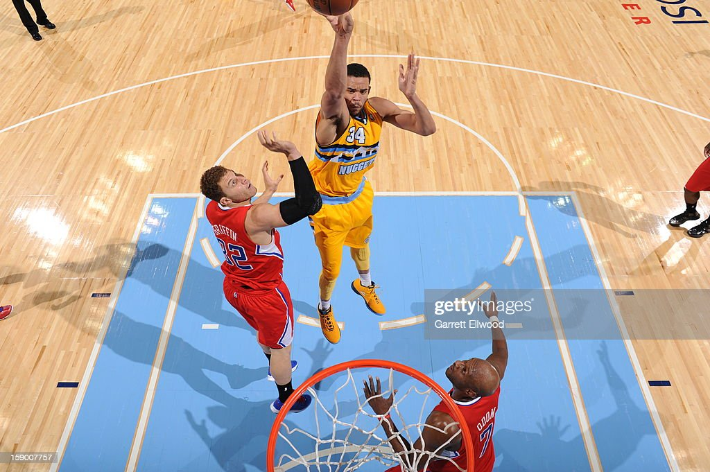 JaVale McGee #34 of the Denver Nuggets puts up a shot against the Los Angeles Clippers on January 1, 2013 at the Pepsi Center in Denver, Colorado.