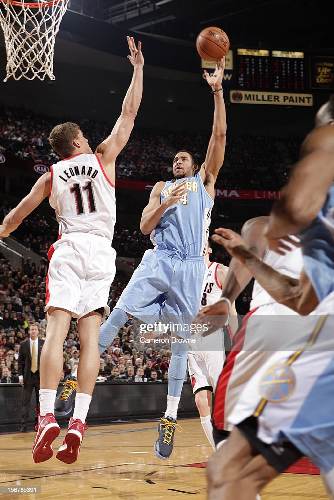 JaVale McGee #34 of the Denver Nuggets puts up a shot against the Portland Trail Blazers on December 20, 2012 at the Rose Garden Arena in Portland, Oregon.