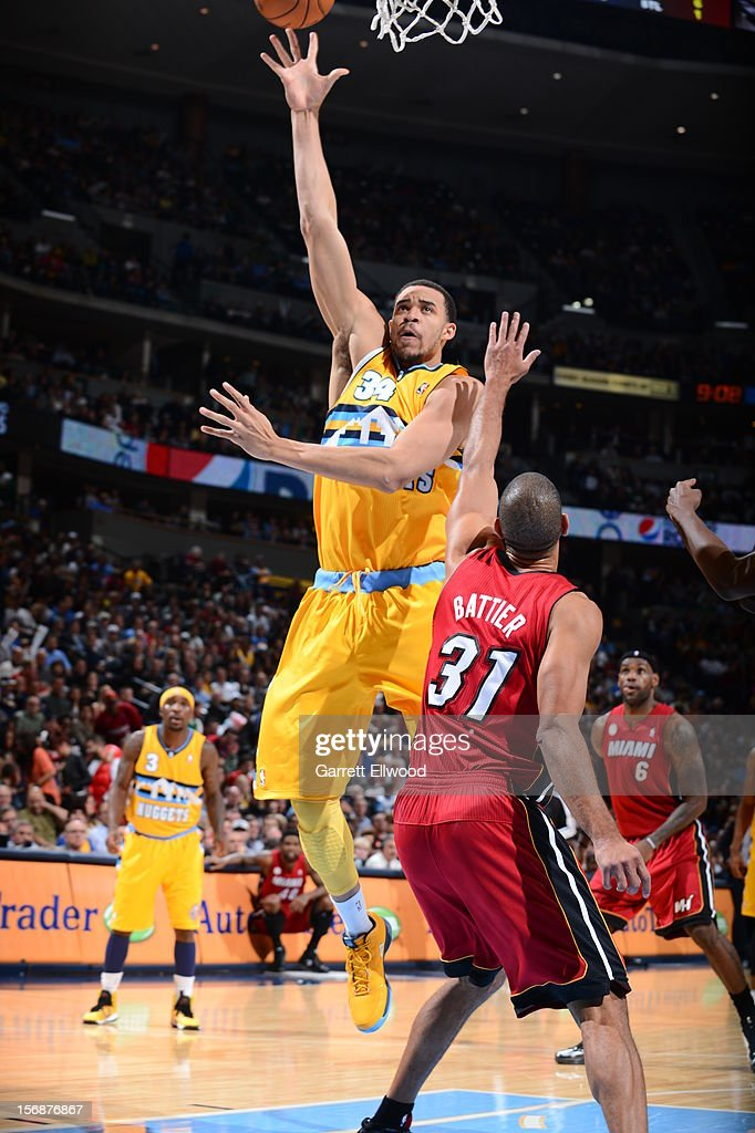 <a gi-track='captionPersonalityLinkClicked' href=/galleries/search?phrase=JaVale+McGee&family=editorial&specificpeople=4195625 ng-click='$event.stopPropagation()'>JaVale McGee</a> #34 of the Denver Nuggets puts up a shot over <a gi-track='captionPersonalityLinkClicked' href=/galleries/search?phrase=Shane+Battier&family=editorial&specificpeople=201814 ng-click='$event.stopPropagation()'>Shane Battier</a> #31 of the Miami Heat on November 15, 2012 at the Pepsi Center in Denver, Colorado.