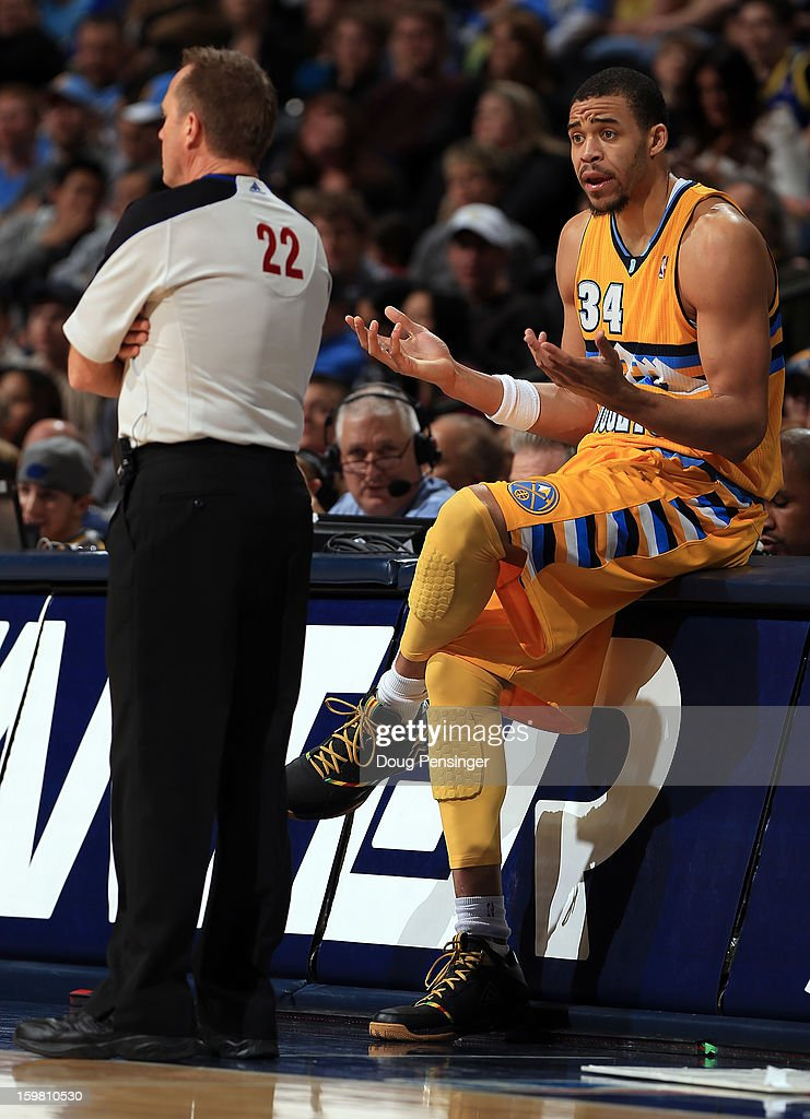 JaVale McGee #34 of the Denver Nuggets questions a technical foul against hims with referee Bill Spooner against the Oklahoma City Thunderat the Pepsi Center on January 20, 2013 in Denver, Colorado. The Nuggets defeated the Thunder 121-118 in overtime.