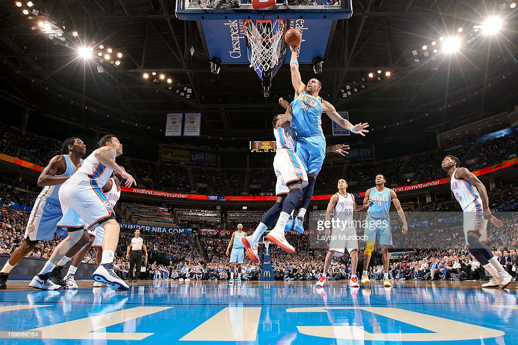 JaVale McGee #34 of the Denver Nuggets rises for a dunk against Hasheem Thabeet #34 of the Oklahoma City Thunder on January 16, 2013 at the Chesapeake Energy Arena in Oklahoma City, Oklahoma.