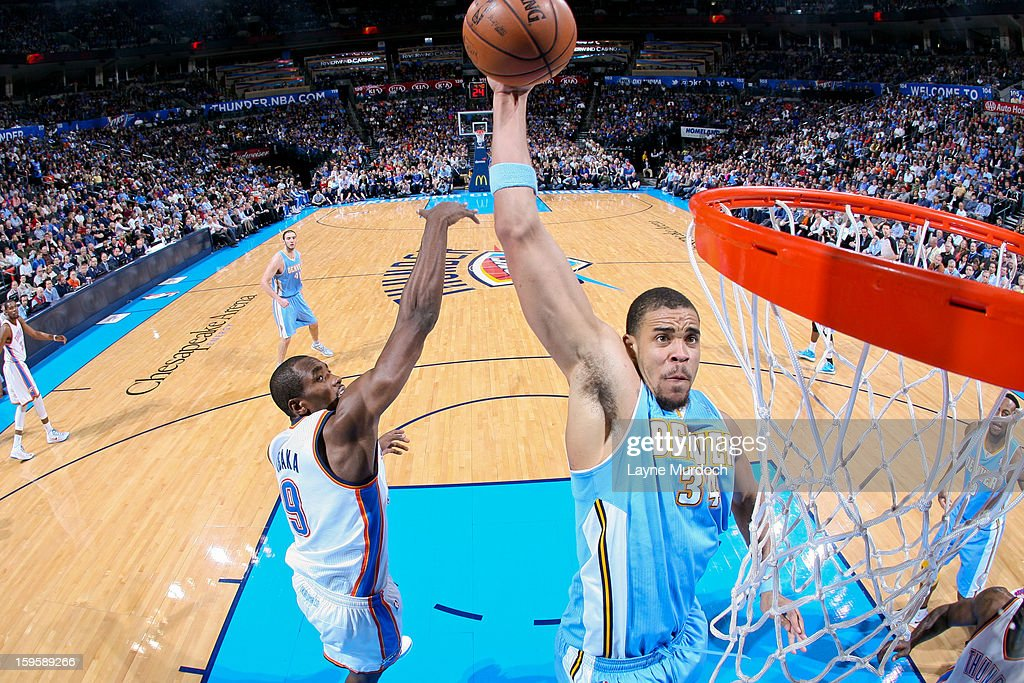 JaVale McGee #34 of the Denver Nuggets rises for a dunk against Serge Ibaka #9 of the Oklahoma City Thunder on January 16, 2013 at the Chesapeake Energy Arena in Oklahoma City, Oklahoma.