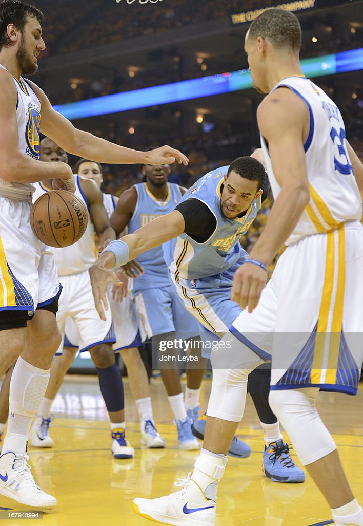 JaVale McGee (34) of the Denver Nuggets scrambles for the ball with Andrew Bogut (12) of the Golden State Warriors during the first quarter in Game 6 of the first round NBA Playoffs May 2, 2013 at Oracle Arena.