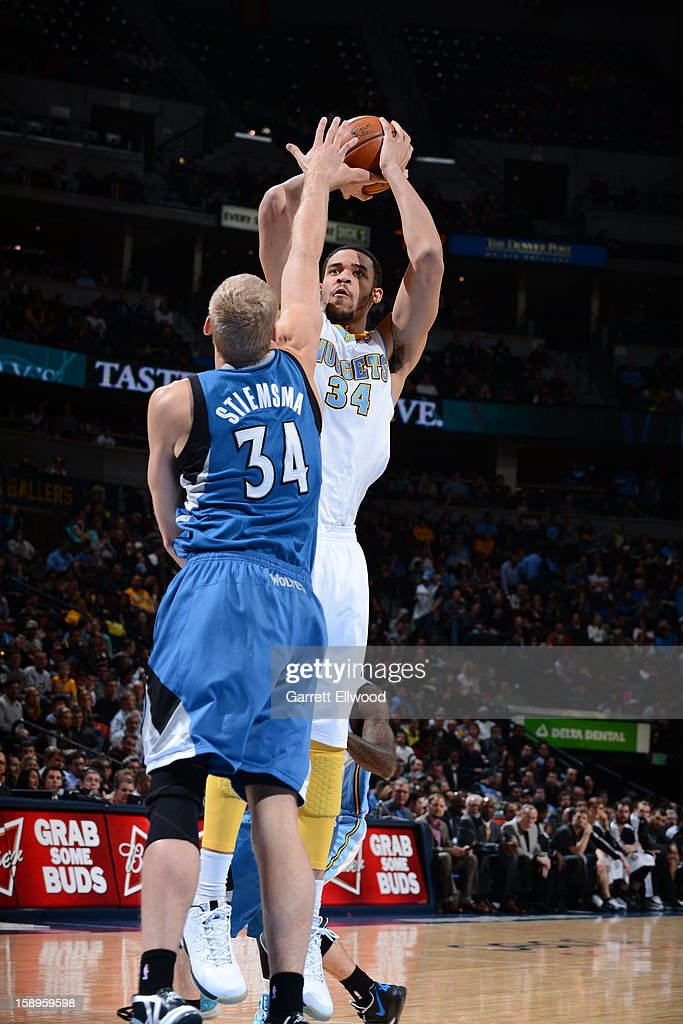 <a gi-track='captionPersonalityLinkClicked' href=/galleries/search?phrase=JaVale+McGee&family=editorial&specificpeople=4195625 ng-click='$event.stopPropagation()'>JaVale McGee</a> #34 of the Denver Nuggets shoots over <a gi-track='captionPersonalityLinkClicked' href=/galleries/search?phrase=Greg+Stiemsma&family=editorial&specificpeople=2098297 ng-click='$event.stopPropagation()'>Greg Stiemsma</a> #34 of the Minnesota Timberwolves on January 3, 2013 at the Pepsi Center in Denver, Colorado.