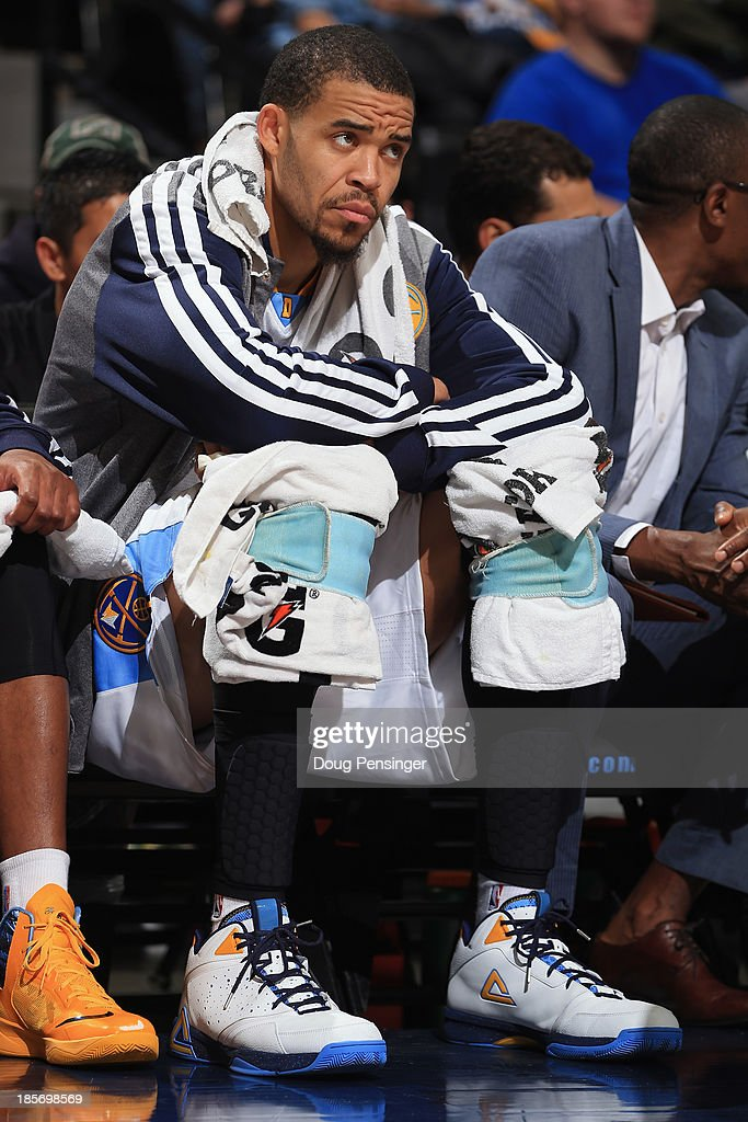 <a gi-track='captionPersonalityLinkClicked' href=/galleries/search?phrase=JaVale+McGee&family=editorial&specificpeople=4195625 ng-click='$event.stopPropagation()'>JaVale McGee</a> #34 of the Denver Nuggets wraps his knees as he sits on the bench against the Phoenix Suns during preseason action at Pepsi Center on October 23, 2013 in Denver, Colorado. The Suns defeated the Nuggets 98-79.