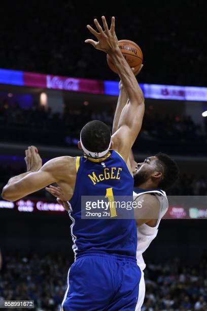 JaVale McGee of the Golden State Warriors blocks KarlAnthony Towns of the Minnesota Timberwolves during the game between the Minnesota Timberwolves...