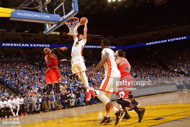 JaVale McGee of the Golden State Warriors dunks the ball against the Chicago Bulls on February 8 2017 at ORACLE Arena in Oakland California NOTE TO...