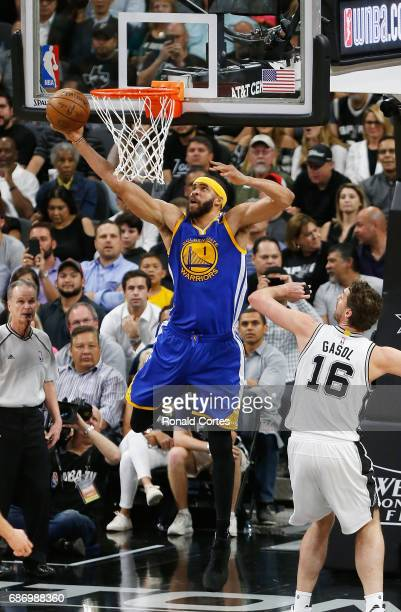 JaVale McGee of the Golden State Warriors dunks the ball in the first half as Pau Gasol of the San Antonio Spurs looks on during Game Four of the...