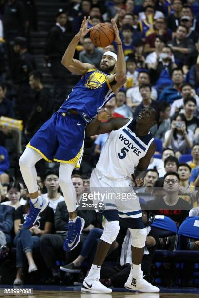 JaVale McGee of the Golden State Warriors in action against Gorgui Dieng of the Minnesota Timberwolves during the game between the Minnesota...