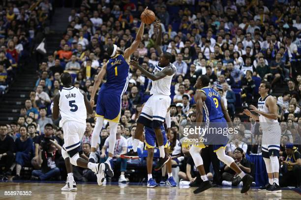 JaVale McGee of the Golden State Warriors in action against Jamal Crawford of the Minnesota Timberwolves during the game between the Minnesota...