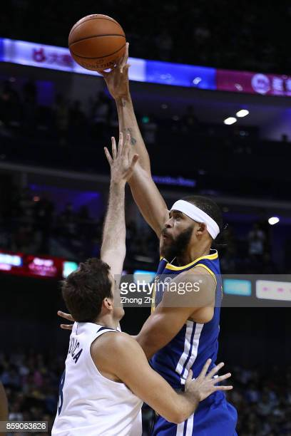 JaVale McGee of the Golden State Warriors in action against Nemanja Bjelica of the Minnesota Timberwolves during the game between the Minnesota...