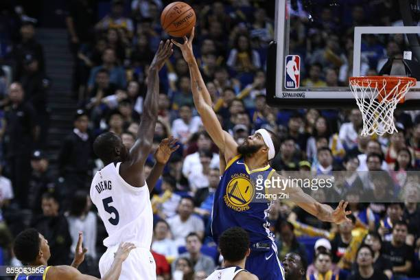 JaVale McGee of the Golden State Warriors in action blocks Gorgui Dieng of the Minnesota Timberwolves during the game between the Minnesota...