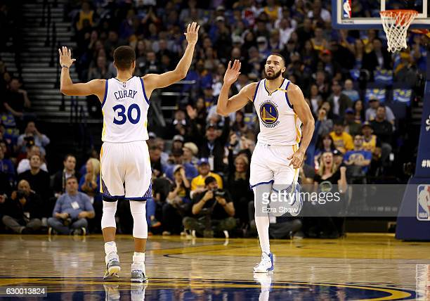 JaVale McGee of the Golden State Warriors is congratulated by Stephen Curry after he dunked the ball against the New York Knicks at ORACLE Arena on...