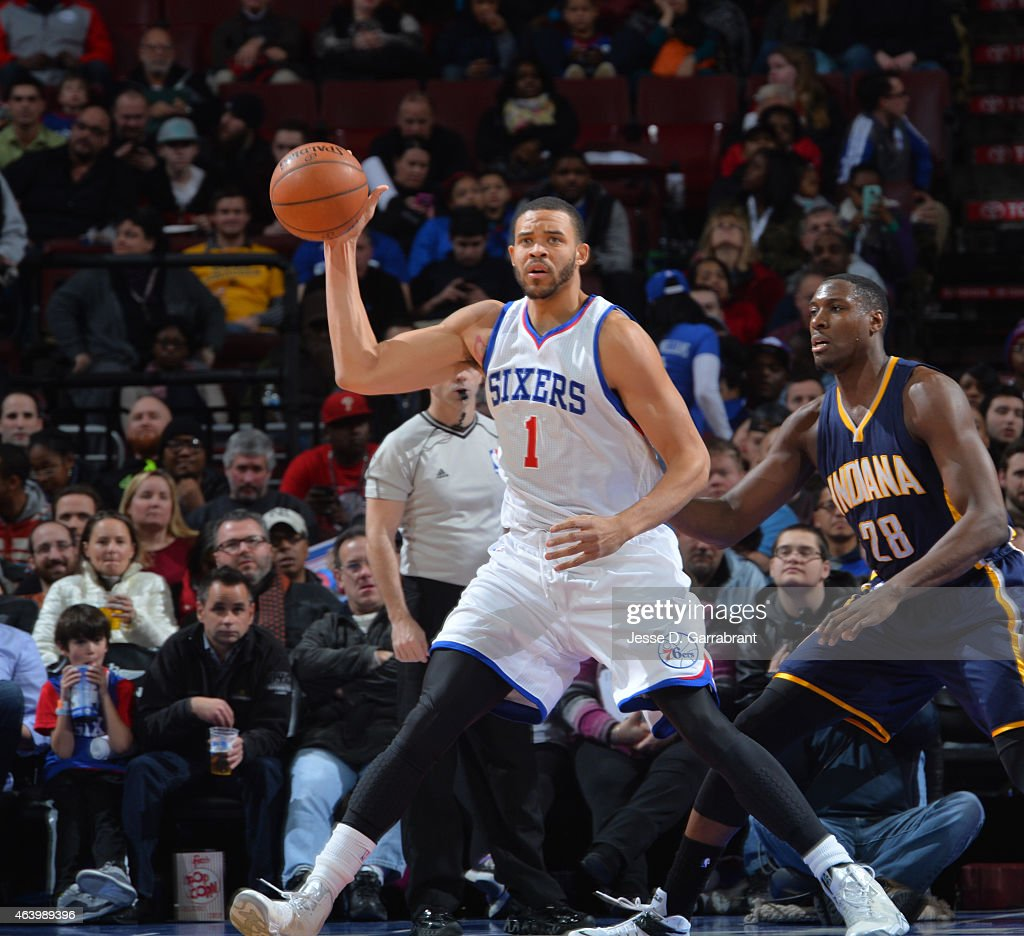 JaVale McGee of the Philadelphia 76ers looks to pass the ball against the Indiana Pacers at Wells Fargo Center on February 20 2015 in Philadelphia...