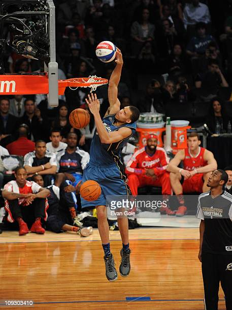 JaVale McGee of the Washington Wizards attempts to dunk three balls during the Sprite Slam Dunk Contest during 2011 AllStar Saturday Night presented...