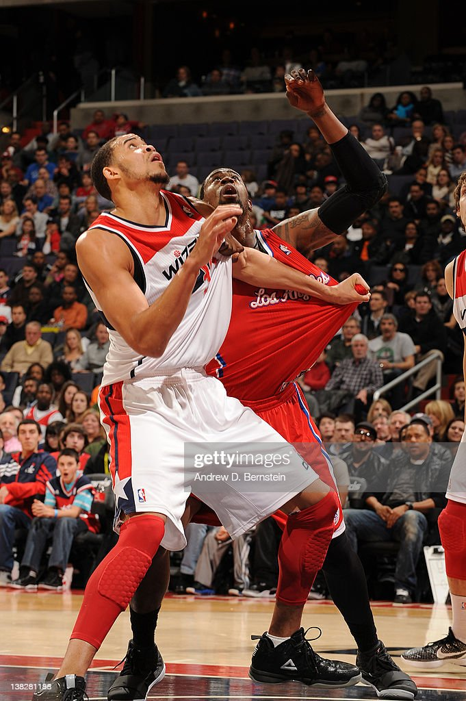 <a gi-track='captionPersonalityLinkClicked' href=/galleries/search?phrase=JaVale+McGee&family=editorial&specificpeople=4195625 ng-click='$event.stopPropagation()'>JaVale McGee</a> #34 of the Washington Wizards battles against <a gi-track='captionPersonalityLinkClicked' href=/galleries/search?phrase=DeAndre+Jordan&family=editorial&specificpeople=4665718 ng-click='$event.stopPropagation()'>DeAndre Jordan</a> #6 of the Los Angeles Clippers during the game at the Verizon Center on February 4, 2012 in Washington, DC.