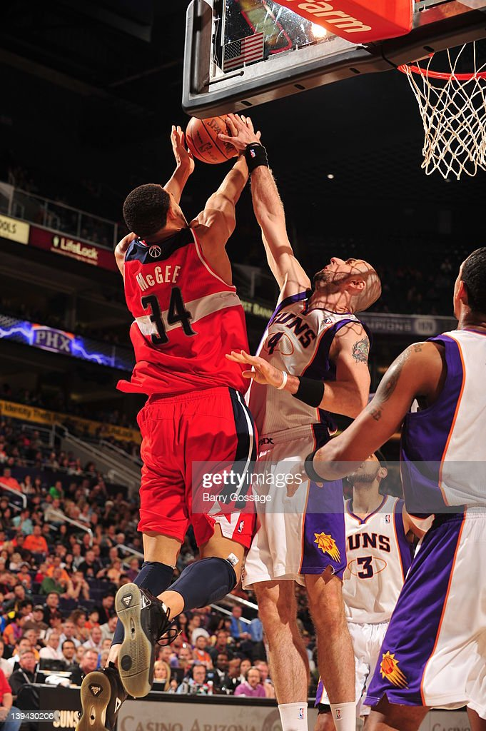 <a gi-track='captionPersonalityLinkClicked' href=/galleries/search?phrase=JaVale+McGee&family=editorial&specificpeople=4195625 ng-click='$event.stopPropagation()'>JaVale McGee</a> #34 of the Washington Wizards battles for a rebound against <a gi-track='captionPersonalityLinkClicked' href=/galleries/search?phrase=Marcin+Gortat&family=editorial&specificpeople=589986 ng-click='$event.stopPropagation()'>Marcin Gortat</a> #4 of the Phoenix Suns on February 20, 2012 at U.S. Airways Center in Phoenix, Arizona.