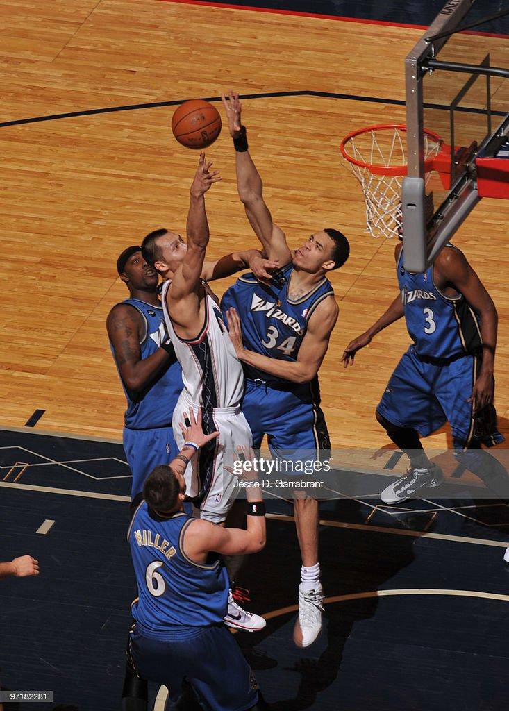 31c2975b9 ... JaVale McGee 34 of the Washington Wizards blocks Yi Jianlian 9 of the  New ...