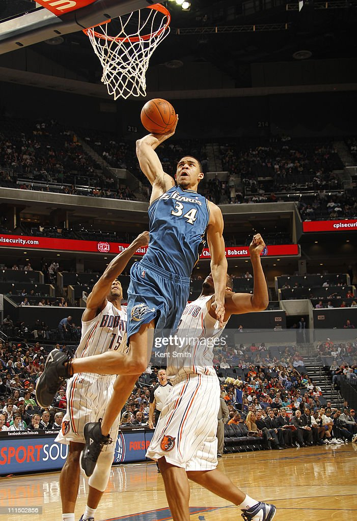 JaVale McGee of the Washington Wizards brings down the dunk against Boris Diaw of the Washington Wizards on April 3 2011 at Time Warner Cable Arena...