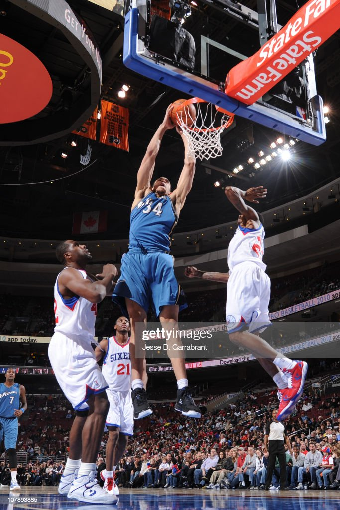 JaVale McGee of the Washington Wizards dunks against Elton Brand and Louis Williams of the Philadelphia 76ers during the game on January 5 2011 at...
