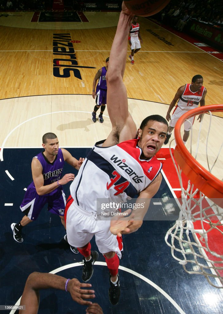 <a gi-track='captionPersonalityLinkClicked' href=/galleries/search?phrase=JaVale+McGee&family=editorial&specificpeople=4195625 ng-click='$event.stopPropagation()'>JaVale McGee</a> #34 of the Washington Wizards dunks against <a gi-track='captionPersonalityLinkClicked' href=/galleries/search?phrase=Francisco+Garcia&family=editorial&specificpeople=198958 ng-click='$event.stopPropagation()'>Francisco Garcia</a> #32 of the Sacramento Kings during the game at the Verizon Center on February 22, 2012 in Washington, DC.